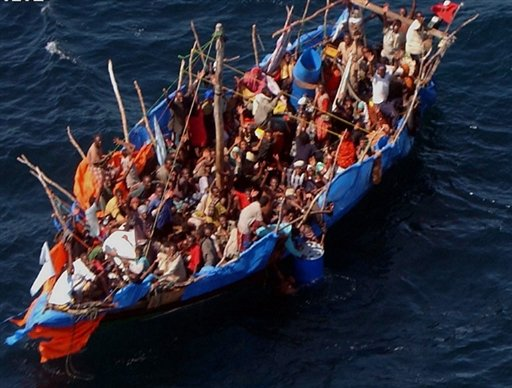 http://ethiopiaforums.com/wp-content/uploads/2011/01/Boat_loaded_with_Ethiopian_and_Somali_immigrants_in_the_Gulf_of_Aden_yemen.jpg