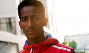 Eritrea's flag-carrying runner and 3 more seeks asylum in UK to flee repressive regime