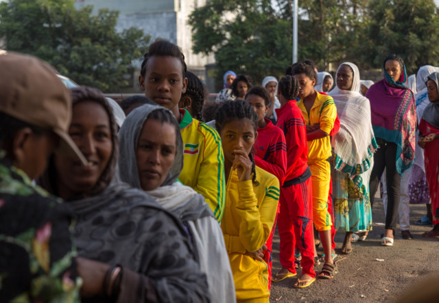 Voters queue early in the morning to cast their votes in Ethiopia's general election, Sunday May 24, 2015, in Addis Ababa