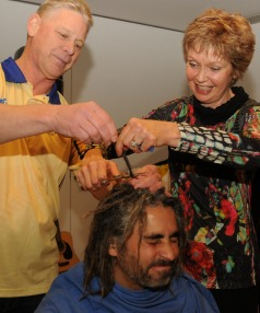 Rotary Club of Hutt City aid project for Ethiopia.  Cameron and Chris Tooley paid for the privilege of taking first snips at the dreadlocks of club president Ganesh Cherian.