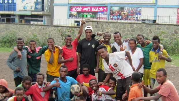 Phoenix Youth squad player Nathanael 'Nati' Hailemariam with street kids in Ethiopia, when he visited his parents' home nation in September as part of a Rotary delegation scoping aid projects.