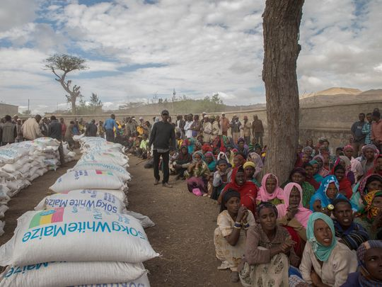 Residents of the Ziway Dugda district of Ethiopia wait