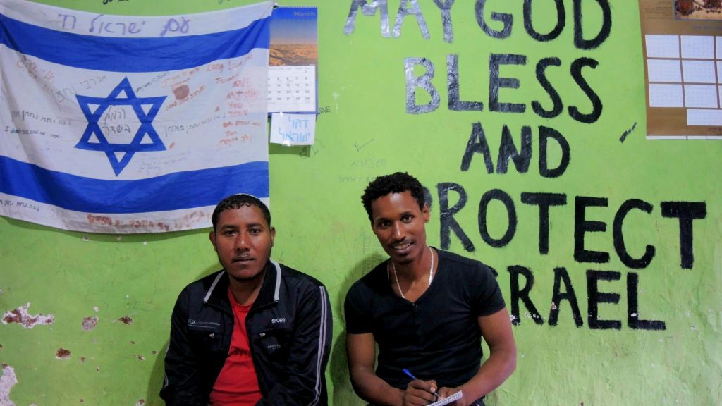 Eyayu Abuhay (right), one of five members of the leadership committee of the Addis Ababa community, and community member Ayeneixi Moges in the youth room at the Addis Ababa synagogue on May 6, 2016. (Melanie Lidman/Times of Israel)