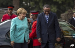 German Chancellor Angela Merkel, left, is welcomed by Ethiopia's Prime Minister Hailemariam Desalegn, as she arrives at the national palace in Addis Ababa, Ethiopia, Oct. 11, 2016.