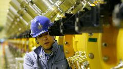 """A worker works on a part of a 330 meters proton linear accelerator at a Japan Proton Accelerator Research Complex """"J-PARC"""" facility in Tokai village, about 130 km (81 miles) northeast of [Tokyo] May 16, 2006. The facility, which is in the process of being built jointly by the High Energy Accelerator Research Organization and the Japan Atomic Energy Agency, is expected to start its operations in 2008. J-PARC aims to pursue frontier science in particle physics, nuclear physics, materials science, life science and nuclear technology, using a new proton accelerator complex at the highest beam power in the world, the facility officials said."""