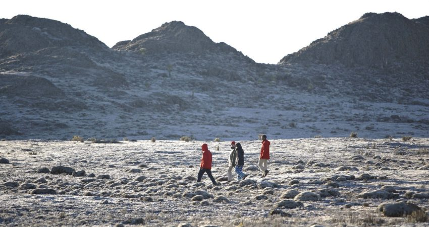 A group strides along the Sanetti Plateau near some of Ethiopia's highest peaks in Bale Mountains National Park.
