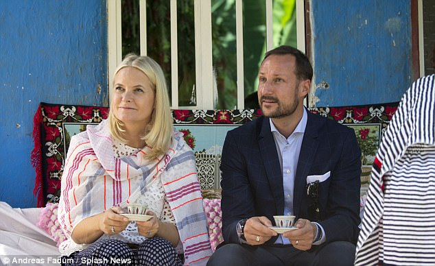 Mette-Marit, 44, and Prince Haakon looked enthralled as they listened to their gracious hosts