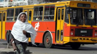 A woman runs in the streets of Addis Ababa