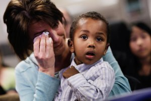 Jamie Lieberman cries as she holds her adopted son Theo, 2, an orphan originally from Ethiopia, after he received American citizenship Nov. 18, 2010, at the U.S. Citizenship and Immigration Services offices in New York City. (Credit: Chris Hondros/Getty Images)