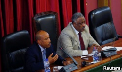 Ethiopia's Defense Minister Siraj Fegessa and speaker of the House of Peoples' Representatives, Abadula Gemeda, address legislators during an emergency meeting to lift the state of emergency, in Addis Ababa, Ethiopia, Aug. 4, 2017.