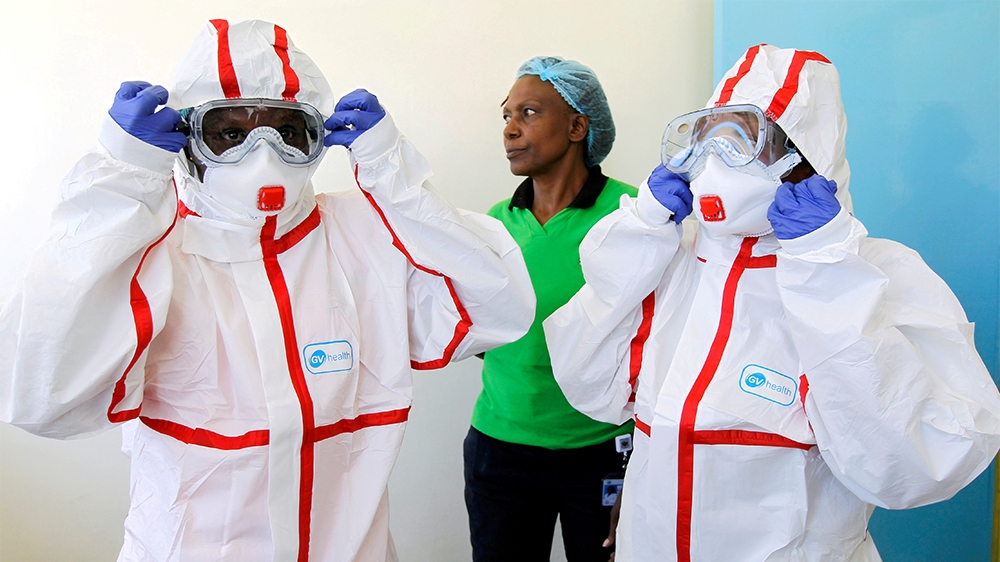 FILE PHOTO: Kenyan nurses wear protective gear during a demonstration of preparations for any potential coronavirus cases at the Mbagathi Hospital, isolation centre for the disease, in Nairobi, Kenya