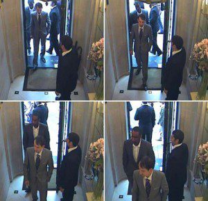 CCTV footage of the robbers wearing stage make-up as they entered the store in New Bond Street