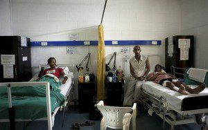 Ethiopian citizen Micky Abebe (R) and Eritrean Samson Tesfai (L) both survivors of an explosion attack rest inside a ward at the International Hospital Kampala, July 12, 2010.