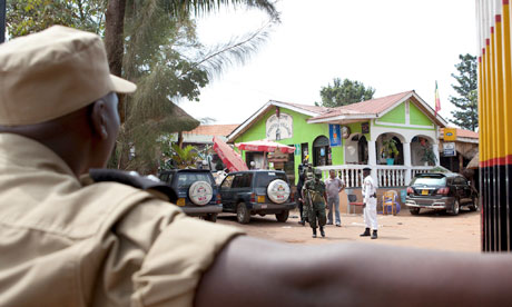 Ugandan police secure the Ethiopian Village restaurant in Kampala, where the first bomb detonated on Sunday. Photo: Reuters