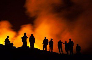 A group of tourists stand watching the lava lake on the Erta Ale volcano in the Afar Region in Ethiopia
