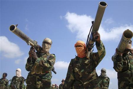 Members of the hardline al Shabaab Islamist rebel group hold their weapons in Somalia's capital Mogadishu, January 1, 2010.