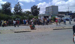 Addis Ababa residents standing in long lines to buy sugar and edible oil