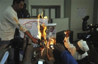 Eritrean refugees residing in Ethiopia burn portraits of President of Eritrea, Isaias Afewerki , during an anti-government protest in Addis Ababa, Wednesday, April 20, 2011. Hundreds of Eritrean exiles demonstrated in the capital of neighboring Ethiopia to protest against their country's autocratic leadership. (AP Photo/Elias Asmare).