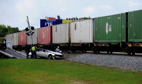 four-men-walk-away-after-train-hit-their-car
