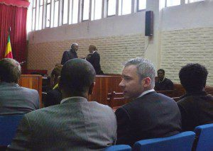Martin Schibbye (2nd right) talks to his lawyer Abebe Balcha in the courtroom in Addis Ababa today (AFP, Jenny Vaughan)