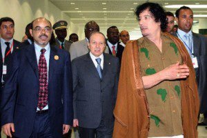 Former Libyan leader the late Muammar Gaddafi, Algeria's President (centre) Abdelaziz Bouteflika and Ethiopia's Prime Minister Meles Zenawi at a NEPAD summit in Sirte, Libya in 2009. Popular Arab revolts have seemingly rattled Mr Zenawi, analysts say. PHOTO   FILE