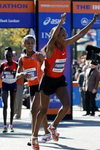 Firehiwot Dadu of Ethiopia celebrates after winning the women's division of the New York City Marathon in New York, Sunday, Nov. 6, 2011. Second-place finisher Buzunesh Deba, from Ethiopia, center, and third-place finisher Mary Keitany, of Kenya, follow behind. Kathy Willens/AP