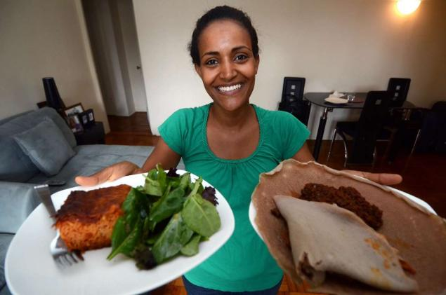 Chef Kubee Kassaye holds up the best of both worlds, an Italian dish and an Ethiopian dish. Kassaye won the 2012 Legacy Award for Culinary Achievement.