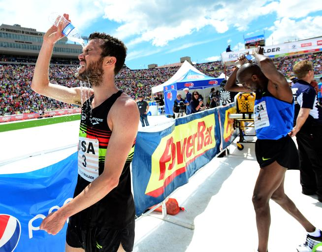 Bobby Curtis and Abdi Abdirahman of the USA Team cool off after finishing the Men's Professional Race at the 2015 Bolder Boulder.