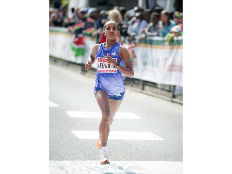 Abebech Afework of Ethiopia is the third woman to finish the marathon at Tamarack Ottawa Race Weekend, Sunday, May 24, 2015.