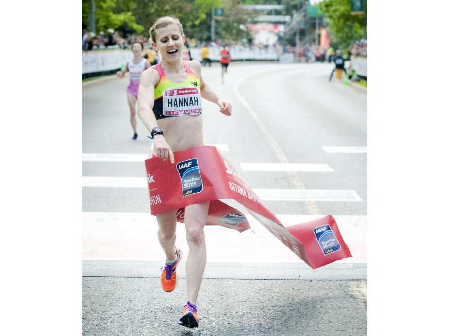 Hannah Rachel celebrates her first marathon with a first Canadian woman title at Tamarack Ottawa Race Weekend, Sunday, May 24, 2015.