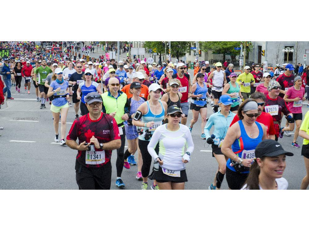 The crowd of runners kick off the first part of the marathon at Tamarack Ottawa Race Weekend, Sunday, May 24, 2015.