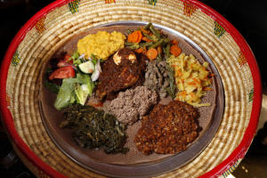 The communal plate with veggie and meat combo is one of the menu items served at Taste of Ethiopia restaurant in El Cerrito, Calif., on Friday, June 26,