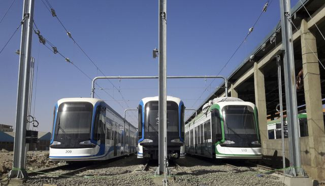 In this photo taken Sunday, March 8, 2015, three trams that were recently brought to Ethiopia from China sit parked at the main hub for the Addis Ababa Light Rail Transit project, aimed at eliminating the lack of public transportation options, during a visit for media to the site in the capital Addis Ababa, Ethiopia. Ethiopia, once known for epic famines that sparked global appeals for help, has a booming economy and big plans these days, with several muscular, forward-looking infrastructure projects undertaken by the government that have fueled talk of this East African country as a rising African giant. (AP Photo)