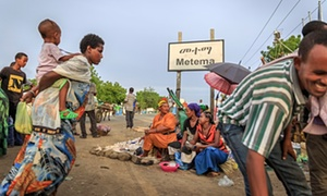 Women sell food at the roadside in Metema, where a crackdown by authorities is failing to stem the tide of migrants trying to leave.