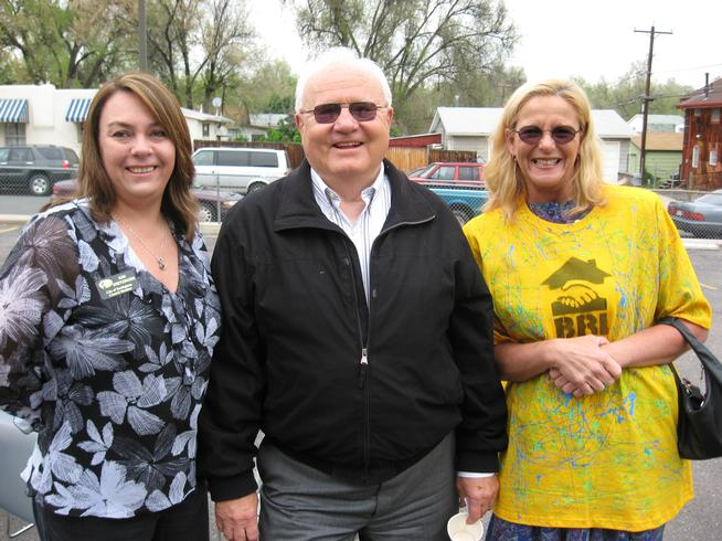 Aurora City Council member Molly Markert, right, last month helped Brothers Redevelopment launch the Paint-A-Thon's 32nd season along with counter-