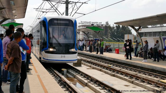 Passengers wait at a tram stop in Ethiopia
