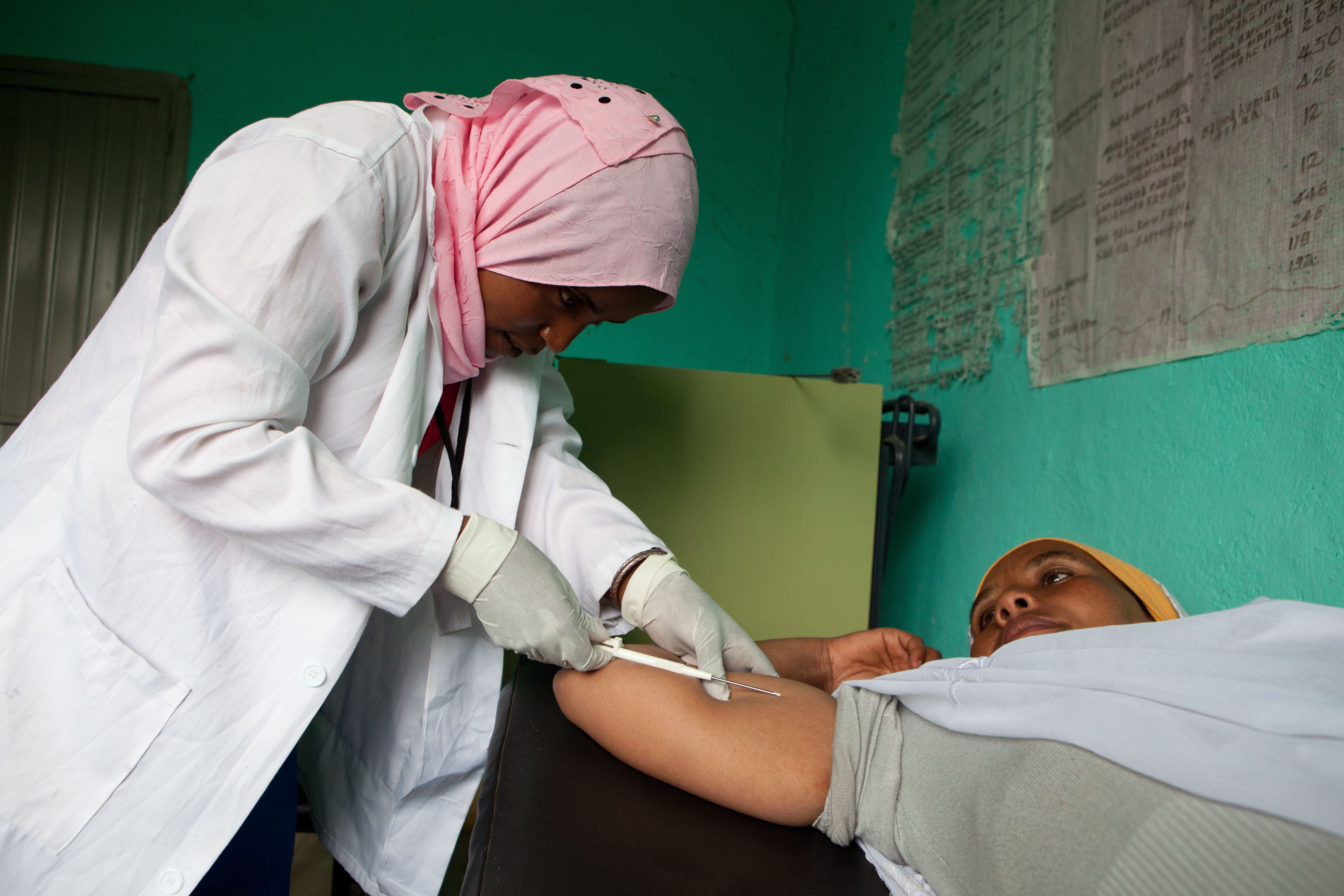 In Ethiopia, a trained health extension worker is inserting an implant.