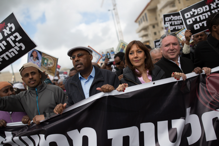 Likud MK Avraham Neguise (second from left). Zionist Union MK Revital Swid (Second from R), and Likud MK David Amsalem (R) during a protest on Ethiopian Israeli immigration in Jerusalem, on March 20, 2016. (Corinna Kern/Flash90 )