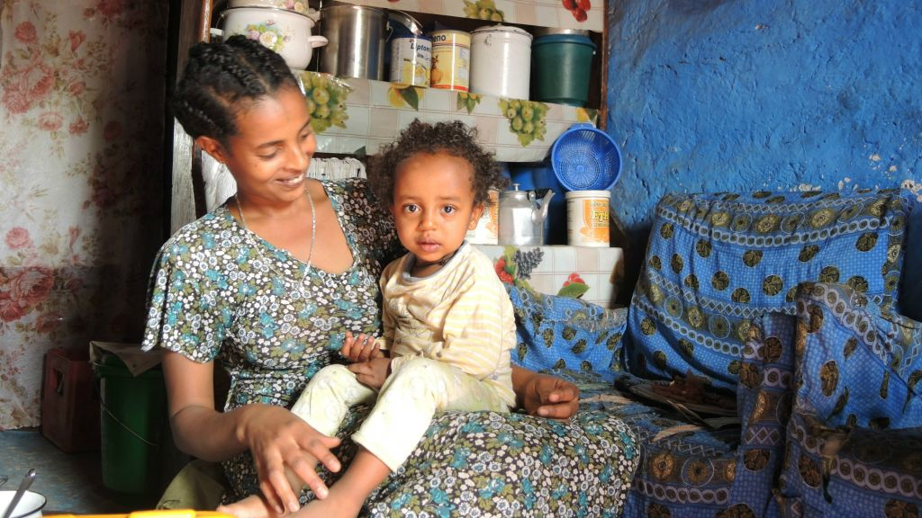 Alementu Lake, 25, a drink seller who lives near the center of Gondar, with her two-year-old daughter, Habtam, who had just woken up from a nap, on April 15, 2016. (Melanie Lidman/Times of Israel)