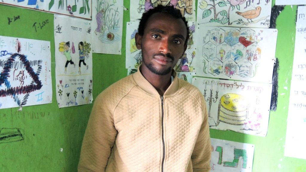 Tigabu Worku, 27, in the youth group meeting room of the Addis Ababa synagogue on May 6, 2016. (Melanie Lidman/Times of Israel)