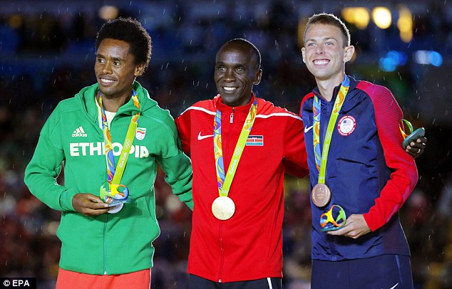 Supporters determined to keep Lilesa (pictured left next to gold medalist Eliud Kipchoge of Kenya and American bronze medalist Galen Rupp) safe have raised $74,410 in one day