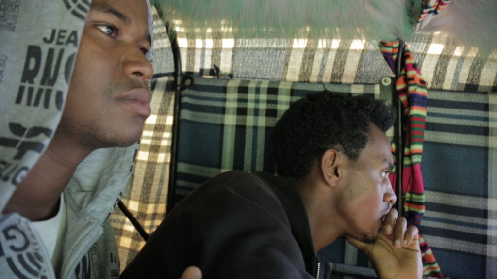 Gezahegn Dereve and Demoz Deboch in a motorcycle taxi in Gondar, Ethiopia, in July, 2016, before heading to the United States for a five week speaking tour. (courtesy Ryan Porush)