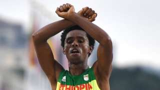 "Ethiopia's Feyisa Lilesa crossed his arms above his head at the finish line of the Men""s Marathon athletics event of the Rio 2016 Olympic Games at the Sambodromo in Rio de Janeiro on August 21, 2016."