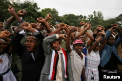FILE - Demonstrators protest gesture during Irreecha, the thanksgiving festival of the Oromo people, in Bishoftu town, Oromia region, Ethiopia. More than 50 people were killed in the violence.