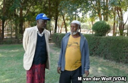 Community Elders Shumi Telila (left) and Ahmed Hamda (right) intervened when protestors were about to attack Maranque Plants, a foreign owned company, Oct. 4, 2016, in the Oromia region, Ethiopia.