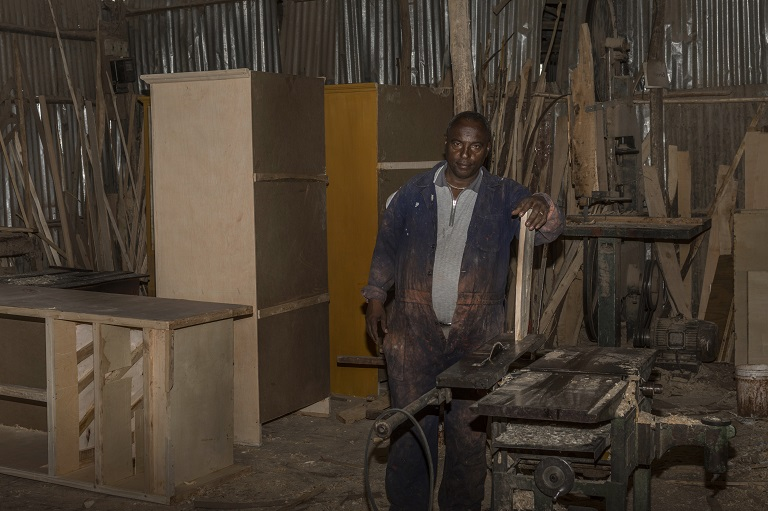 Tadese Sheferaw came up in the world through hard work as a carpenter, and two of his eight children have followed in his footsteps. Photo by Maheder Haileselassie Tadese