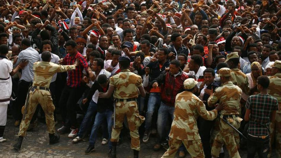 Ethiopian security hold back demonstrators chanting slogans during Irreecha, the thanksgiving festival of the Oromo people, in Bishoftu town, Oromia region, Ethiopia, October 2, 2016.