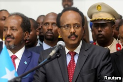 FILE - Somalia's President Mohamed Abdullahi Farmajo addresses lawmakers after his election victory in Mogadishu, Feb. 8, 2017. Mohamed was prime minister during the nation's 2011 famine disaster.