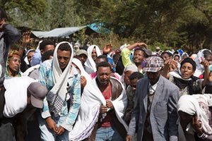 People in Yubdo village, in Ethiopia's Oromia region, mourn the death of Dinka Chala in December 2015