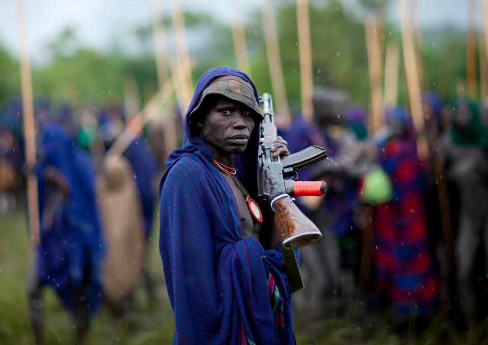 A warrior clutches his AK-47. In recent years, some Suri fights are said to have ended up in gun battles